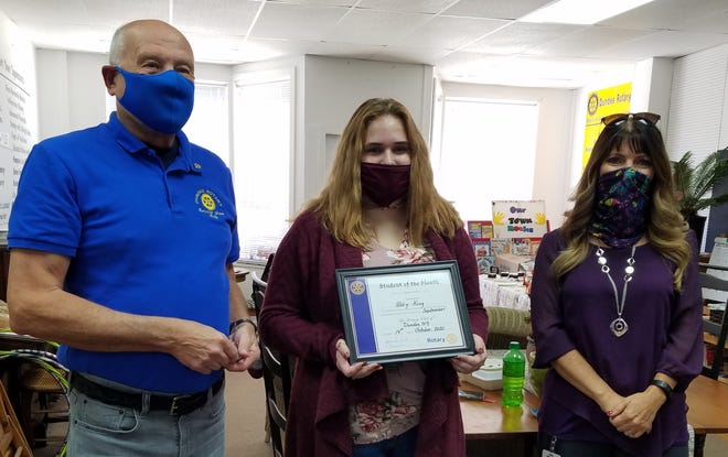 Dundee High School senior Abby King (center) received the first Rotary Student of the Month award from President John Frederick (left). Abby was accompanied to the meeting by Rotarian and DCS Superintendent Kelly Houck (right).