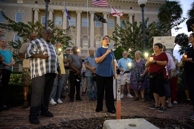 A minister recites a Bible verse that comes to mind at the Interfaith Prayer Vigil at the Lake County Historical Museum on Oct. 24, 2019. The Interfaith Council of Lake County is hosting a Sacred Storytelling event on Zoom on Thursday.
