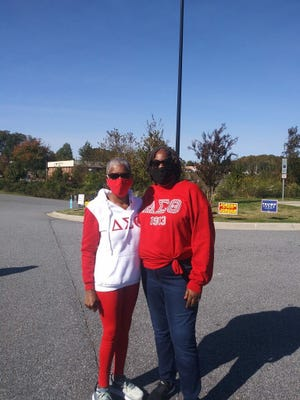 """June Britt and Debra Verdell, members of Lexington (N.C.) Chapter of Delta Sigma Theta Sorority Inc., participated in the """"Souls to the Polls"""" event in Lexington. It was a community collaborative effort to transport and to register first-time voters. They marched from the town square to the Board of Elections building."""