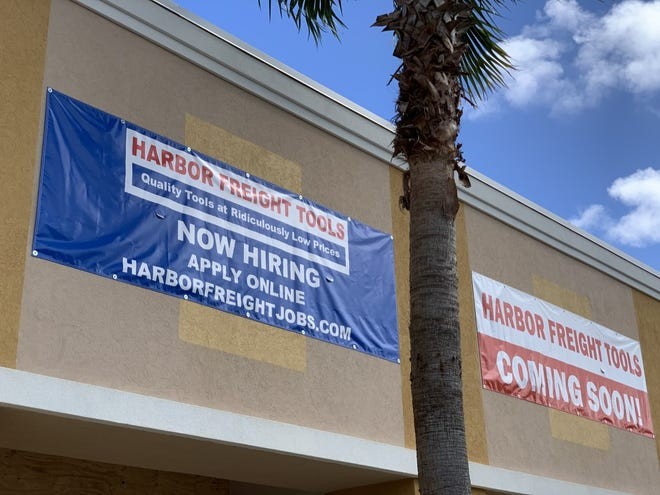 """""""Coming Soon"""" and """"Now Hiring"""" banners hang over the future Harbor Freight Tools store set to open in earl7 2021 at the Publix-anchored shopping center at the corner of Dunlawton Avenue and Nova Road in Port Orange on Tuesday, Oct. 27, 2020."""