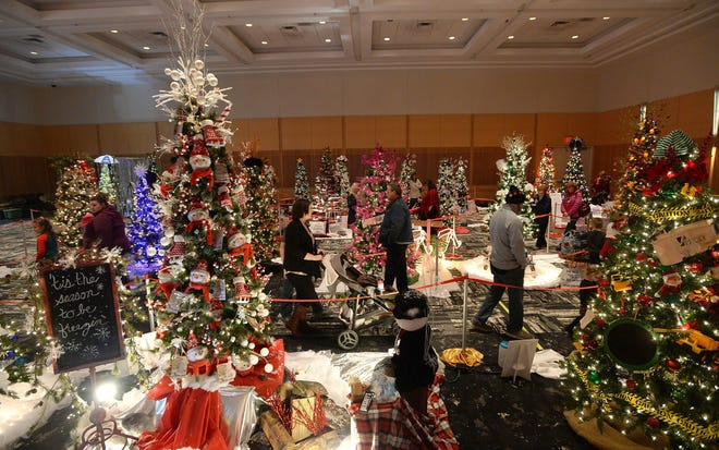 Visitors look at the decorated trees on display during the 2019 Festival of Trees at the Bayfront Convention Center. Due to the coronavirus, this year's festival will have drive-thru and virtual options.