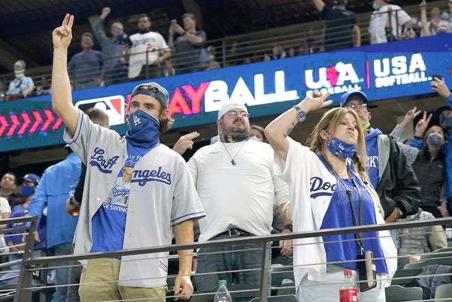 Los Angeles Dodgers fans cheer during the seventh inning of World Series Game 5 against the Tampa Bay Rays Sunday in Arlington, Texas.