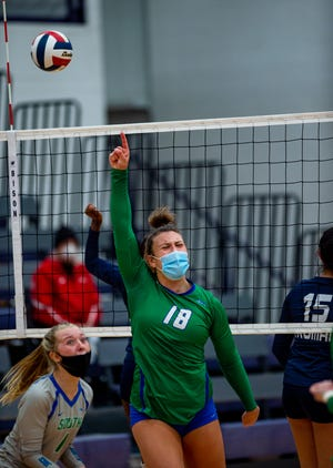 Blue Springs South's Aubrey LaPour celebrates after knocking down a kill in the Jaguars' 3-0 win over Truman in the Class 5 District 14 semifinals Monday at Blue Springs High School.