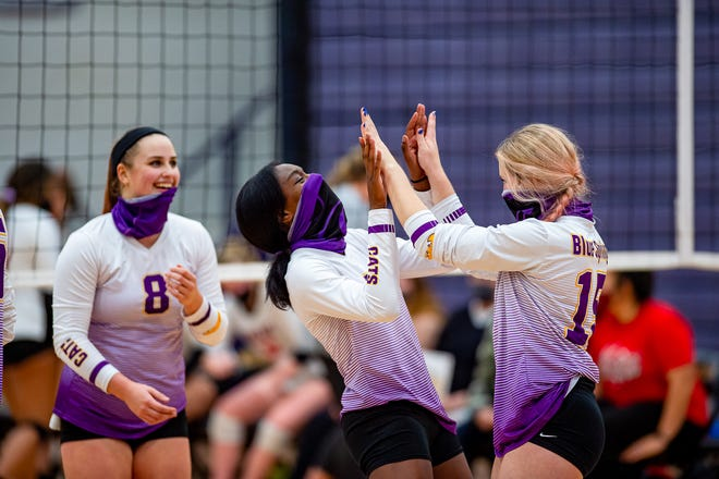 Blue Springs' Lily Letchworth (8), Olivia Dixon, center, and Nikole Schnell celebrate after defeating Fort Osage 3-0 in their Class 5 District 14 semifinal Monday. The host Wildcats advanced to Wednesday's championship against rival Blue Springs South.