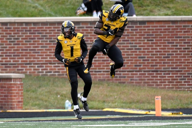 Missouri running back Larry Rountree III, right, celebrates with teammate Tyler Badie (1) after scoring on a 1-yard run during the second half of Saturday's game against Kentucky. Rountree had a career-high 37 times for 126 yards in a 20-10 win.