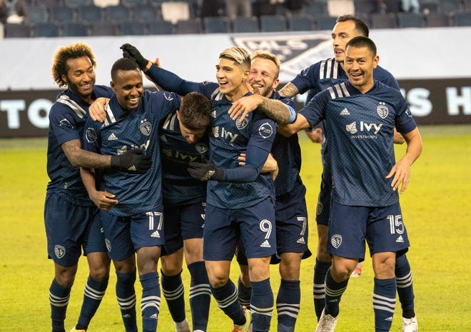 Sporting Kansas City forward Alan Pulido (9) celebrates with teammates after scoring a goal during the second half of Saturday's game against the Colorado Rapids at Children's Mercy Park. Sporting KC moved into first place in the Western Conference with a 4-0 win.