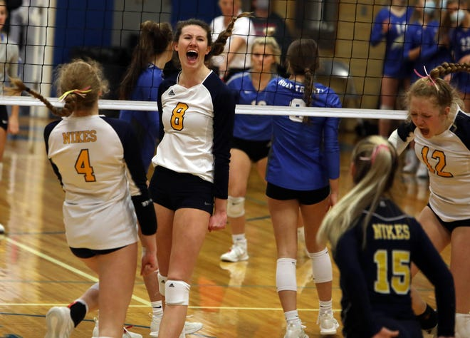 Notre Dame High School's Gabby Deery (8) celebrates a point Monday with teammates during their Class 1A Region 8 semifinal match against Holy Trinity High School at Fort Madison.