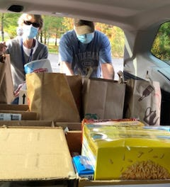 ARA Volunteers loading donated goods earmarked for food pantries.