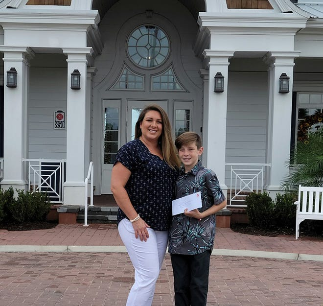Beacon Lake Resident Manager Venus Durden and her son are taking part in the community pen pal initiative with Westminster Woods.