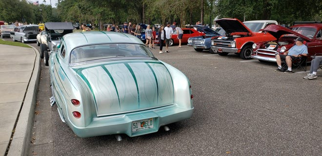 Buzz St. Johns' 1951 Mercury lead sled (left) and other classics at a recent Cruise Fruit Cove.