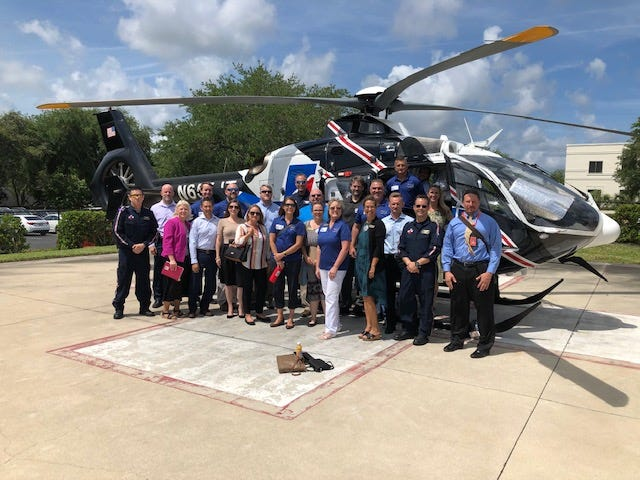 The members of a recent Leadership St. Johns Class gather during Health Day in front of the Flagler Health+ helicopter. Applications and nominations for the 2021 program are due by Nov. 24.