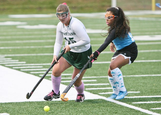 Oakmont's Ella Lafortune (15) advances the ball around Gardner High's Rozeli Gonzalez during a game at Arthur I. Hurd Memorial Field in Ashburnham last year. Now a senior, Lafortune is one of five team captains for the Spartans this season.