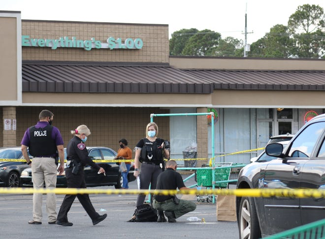 Kinston Police Department officers investigate a shooting that occurred in the Walmart shopping center parking lot Tuesday, October 27, around 12:45 p.m. [Brandon Davis/Kinston Free Press]