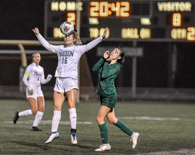 Hudson junior Marissa Ludewig heads the ball in front of Nordonia freshman Kayla Wosnick during the Explorers' 8-2 win in Division I district semifinal at Boliantz Stadium in Macedonia.