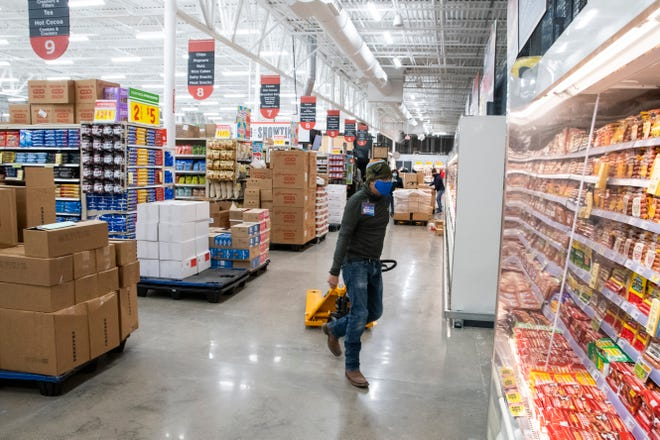 Employees prepare the new HEB store for the grand opening on Tuesday, Oct. 27, 2020, in Lubbock, Texas.
