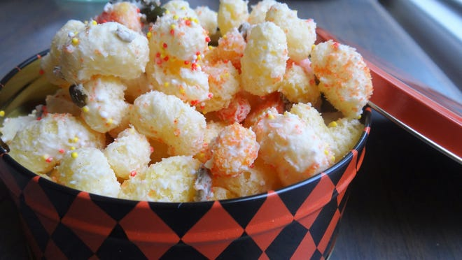If you keep the kids in for Halloween, throw together this colorful, sweet-n-salty mix made with puffed corn/rice, (it's called Pirate Booty on the chip aisle of the grocery store).