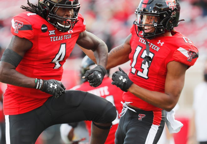 Texas Tech running back SaRodorick Thompson (4) celebrates a touchdown with wide receiver Erik Ezukanma (13) during the first half of a Big 12 Conference game Saturday, Oct. 24, 2020 against West Virginia at Jones AT&T Stadium.