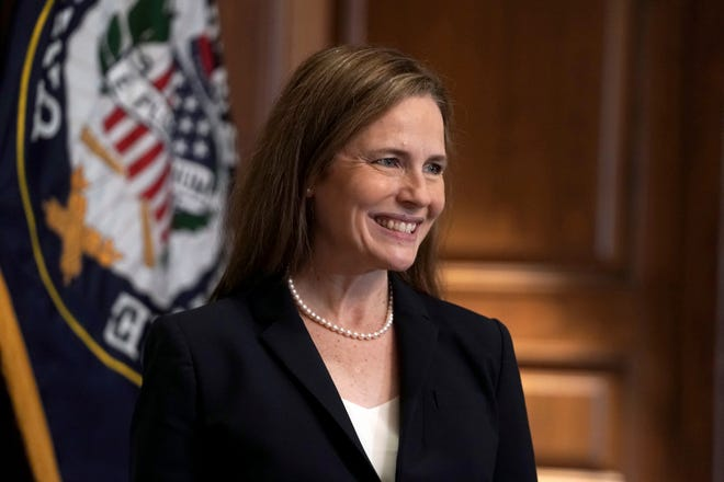 Supreme Court nominee Amy Coney Barrett, meets with Sen. Martha McSally, R-Ariz., on Wednesday on Capitol Hill in Washington.