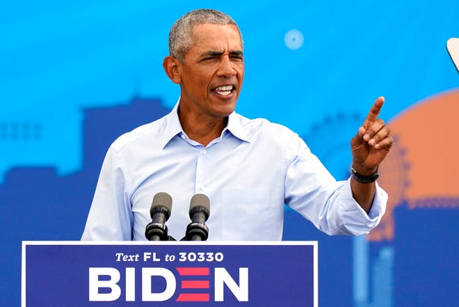 Former President Barack Obama speaks at a rally as he campaigns for Democratic presidential candidate former Vice President Joe Biden Tuesday, Oct. 27, 2020, in Orlando.