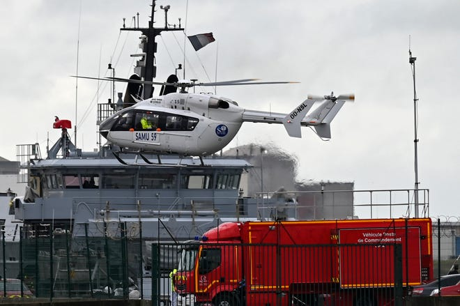 A French rescue helicopter lands close to a rescue vessel in Dunkirk, northern France, on Tuesday during a search operation after four migrants, including a 5-year-old and 8-year-old child died Tuesday when their boat capsized while they and other migrants tried to cross the English Channel to Britain, French authorities said. Fifteen migrants have been saved so far and rescue and search operations are still under way, according to the regional administration for the Nord region.