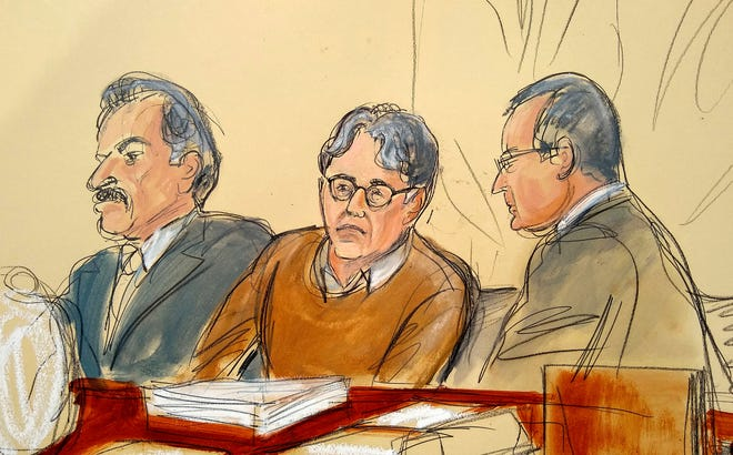 Defendant Keith Raniere, center, leader of the secretive group NXIVM, is seated between his attorneys Paul DerOhannesian, left, and Marc Agnifilo during the first day of his sex trafficking trial in May 2019. Raniere, a self-improvement guru whose organization NXIVM attracted millionaires and actresses among its adherents, was sentenced Tuesday on convictions that he turned some female followers into sex slaves branded with his initials.