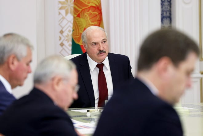 Belarusian President Alexander Lukashenko attends a meeting in Minsk, Belarus, on Tuesday. Factory workers, students and business owners in Belarus have started a general strike, calling for authoritarian Lukashenko to resign after more than two months of mass protests triggered by a disputed election.