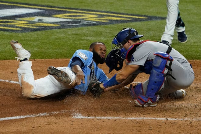 Tampa Bay Rays' Manuel Margot is tagged out at home by Los Angeles Dodgers catcher Austin Barnes trying to steal during the fourth inning in Game 5 of the baseball World Series Sunday, in Arlington, Texas. TONY GUTIERREZ/THE ASSOCIATED PRESS