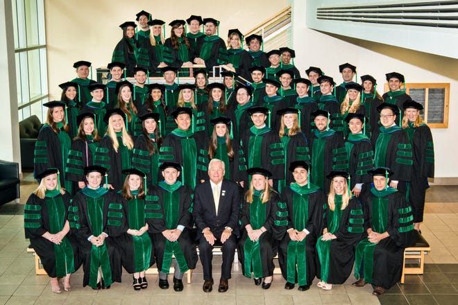 Dr. Michael Dennis, center, is shown with the Charles E. Schmidt College of Medicine's 2015 Graduating Class.