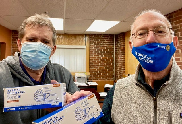 Bob Hamilton, president of the Exeter Rotary Club, distributes 1,600 face masks to Rusty Lyster, director of facilities for SAU 16.