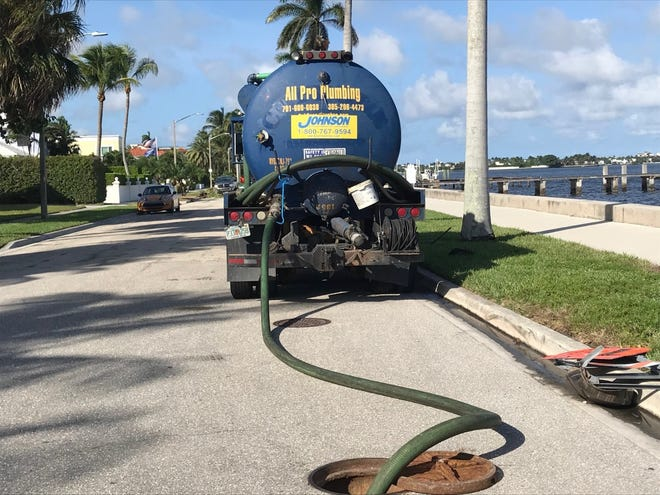 A steady flow of vacuum trucks are sucking up a mix of rainwater and sewage from an over-taxed storm water system near West Palm Beach's South Flagler Drive waterfront.