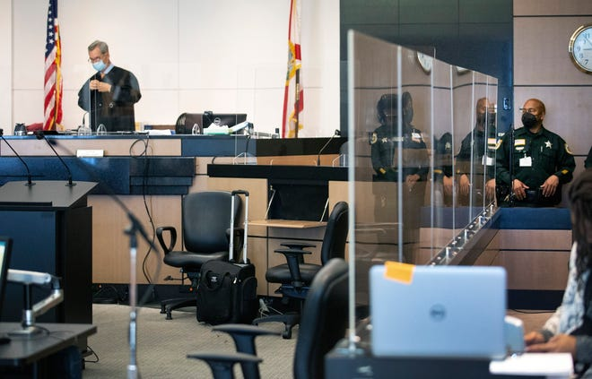 Circuit Judge Joseph Marx dons his robes before the start of court Tuesday in West Palm Beach.