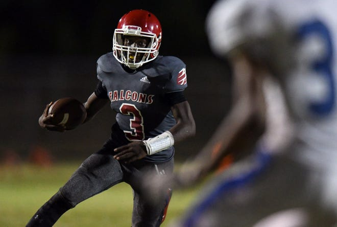 In this 2019 photo, Forest Hill quarterback Jalen Jeter looks for running room late in a game against Wellington. On Saturday, Jeter scored the game-winning touchdown as a makeshift Falcons team beat Palm Beach Lakes 27-26.