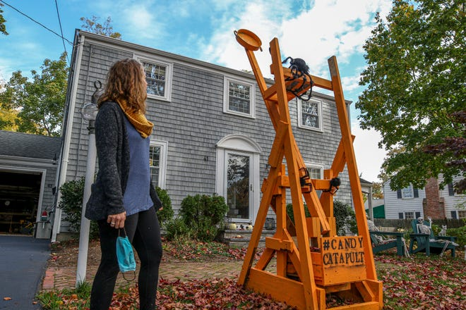 Barrington mom Lindsey Hingorany takes no credit for the building of this candy catapult her husband and sons erected for Halloween visitors. [The Providence Journal / David DelPoio]