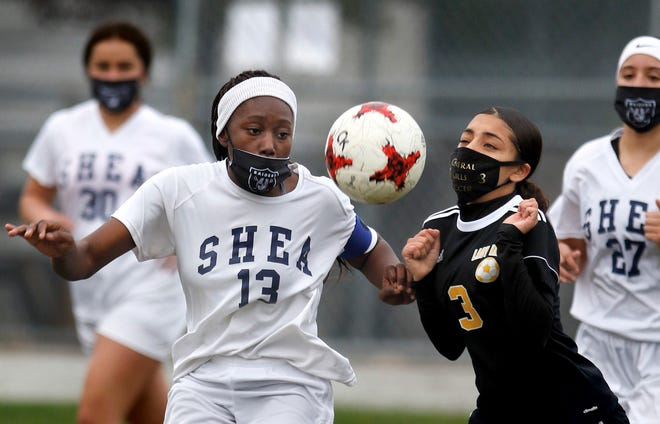 Shea's Bitenga Namusse and Central's Tuana Paz move in on a bouncing ball during Tuesday's match up.  [The Providence Journal / Kris Craig]