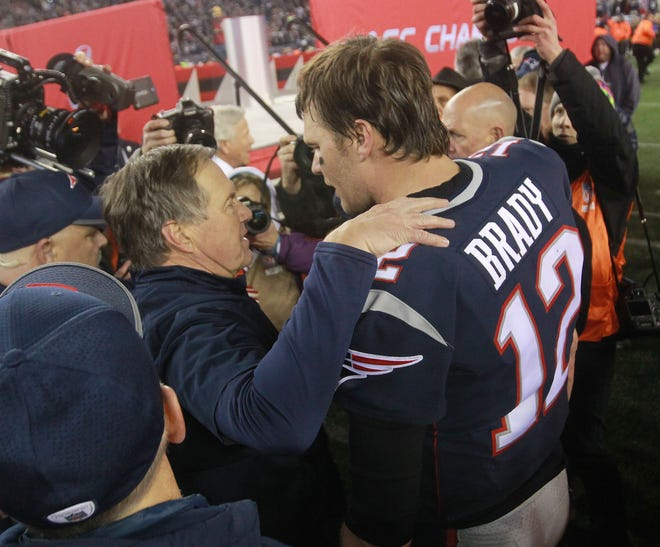 Patriots coach Bill Belichick and quarterback Tom Brady celebrate after they won the AFC championship in January 2018.