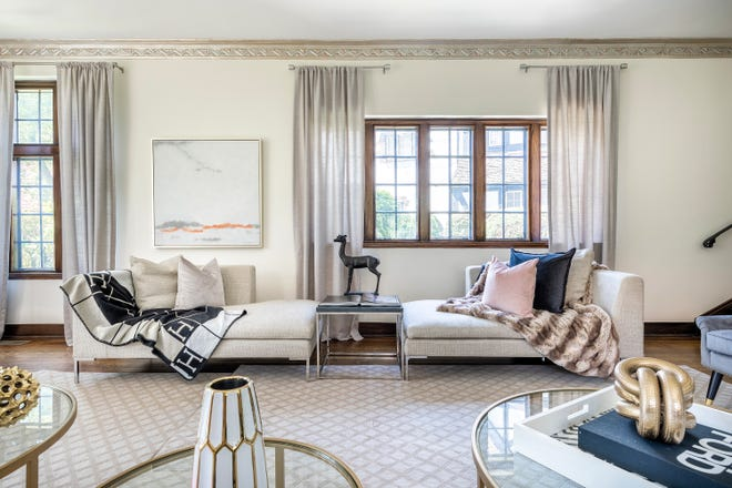 Soft pink accents including artwork help bring out architectural elements such as ceiling moldings with pink undertones.