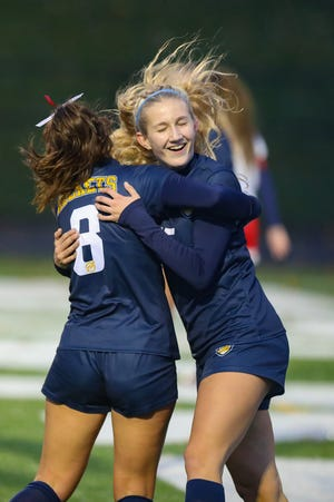 Streetsboro juniors Ella Deevers, left, and Emma Flick celebrate after Flick scores on an assist from Deevers.