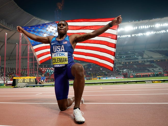 Christian Coleman celebrates after winning the gold medal in the men's 100 meters at the World Athletics Championships in Doha, Qatar, on Sept. 28, 2019.