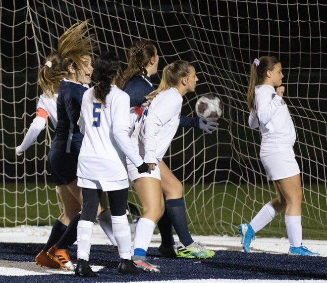 Fairless' Kenzie Pavlik (left) reacts after teammate Gracie Ashton scored a goal following a corner kick during the second half against Brooklyn on Monday, Oct. 26, 2020. (Special to The Canton Repository / Bob Rossiter)