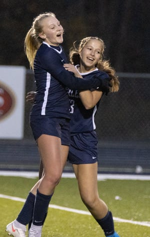 Fairless's Gracie Ashton (left) celebrates her tying goal with teammate Julia Seward during the first half against Brooklyn on Monday, Oct. 26, 2020. (Special to The Canton Repository / Bob Rossiter)