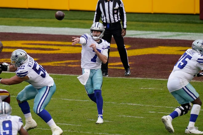 Dallas Cowboys quarterback Ben DiNucci (7) throws downfield in the second half of an NFL football game, Sunday, in Landover, Md. Washington won 25-3.