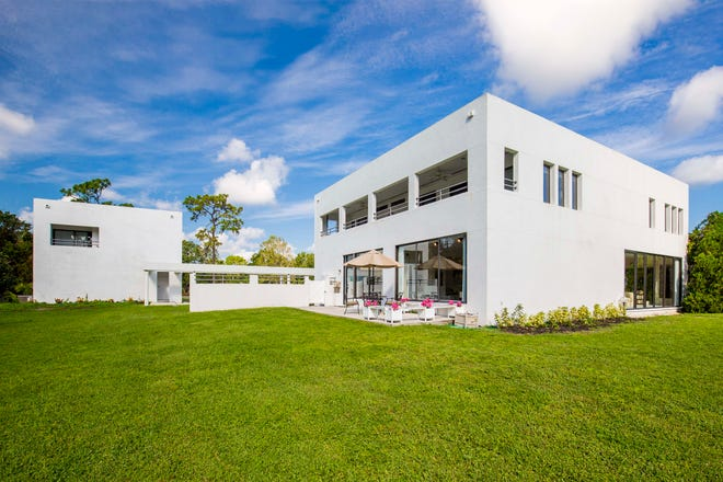 The striking, modern home in the quiet woodland community of Foxfire West in Sarasota is for sale for $865,000 through Lee Byron and Susan Keal of Michael Saunders & Company. (Photo / Denis Lauzon)