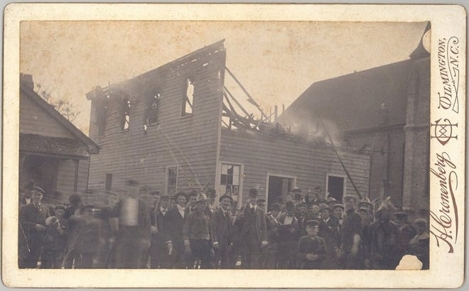 The white supremacist mob outside of The Daily Record Building they burned on Nov. 10, 1898 during a day of violence that claimed an untold number of Black lives.