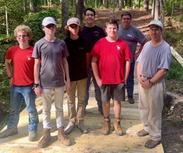 Jonathan Swimmer, second from left, and scouts and scout leaders from Troop 13 are pictured on the recently completed bridge extension at the New Bern Battlefield Park. [CONTRIBUTED PHOTO]