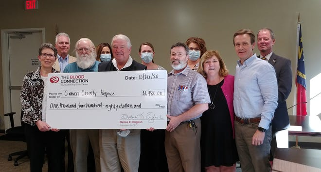 A reception was held at Trent Woods Town Hall Monday, Oct. 26 to present a check from The Blood Connection to Craven County Hospice. Next blood drive will be held here at Town Hall Dec. 2 from 1 p.m. to 6 p.m. You may call the Trent Woods Town Hall for more information, 252-637-9810. [CONTRIBUTED PHOTO]