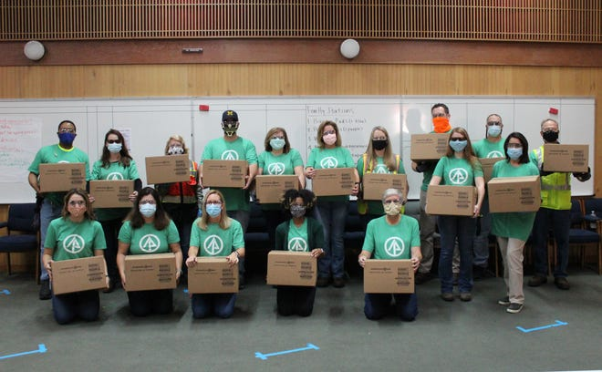 International Paper recently packed and donated feminine hygiene products to local schools. [CONTRIBUTED PHOTO]