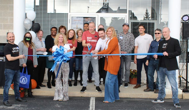 The Rehoboth Beach–Dewey Beach Chamber of Commerce held a ribbon-cutting ceremony Oct. 23 to celebrate new member Iron Valley Real Estate, with its flagship office at 19323 Lighthouse Plaza Blvd. No. 6, Rehoboth Beach. From left, back row, are Abigail Kaiser, Glenn Fornoff, Lynette Griffin, Jill Cicierski, Nicole Quillen, Marian Campo, Corey Kaplan, Jason Navillat, Frank Hornstein, Jay Lesko, Rob Cleapor, Ed Stratton and Kosta Tsouklas; front row, Eric Leadbetter, Sherri Custodio, Mary Schaub and Adam Gamble.