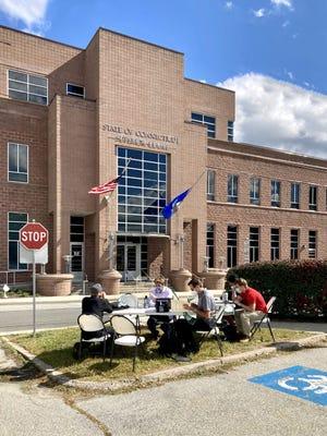 Public defenders outside Danielson court in September.