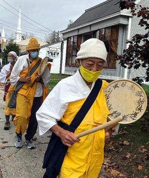 Members of the New England Peace Pagoda brought their Listening to the Call of the Great Spirit walk through Lancaster last weekend. According to the group's website, the walk marks the 400th anniversary of the landing of the Mayflower, and 400 years of Colonization of native people. [Photo for The Item]