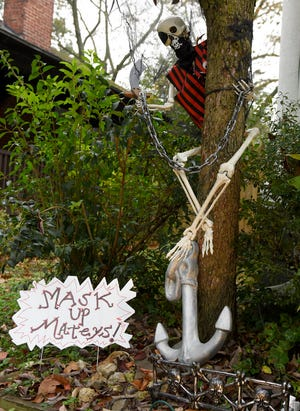 Pirate-themed Halloween decorations, reminding people to be safe while trick-or-treating during the COVID-19 pandemic, are seen at a home in Palmyra, N.J.